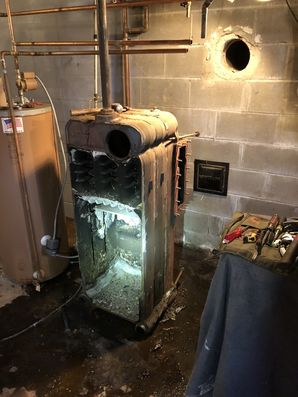 Before and After of a 65-year-old Oil Boiler Replacement in Center Moriches, NY (2)
